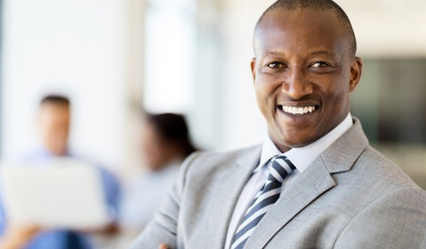 smiling man in business suit_GettyImages-517102892