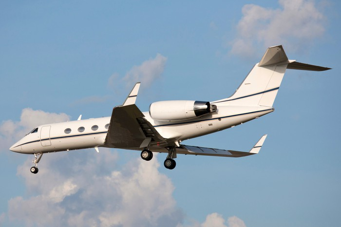 Gulfstream jet with landing gear extending