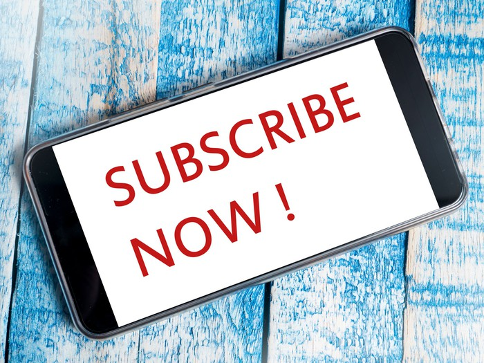 Smartphone with the words Subscribe Now on it.