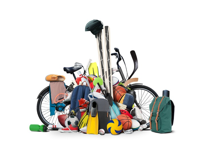Sporting goods piled around a bicycle.