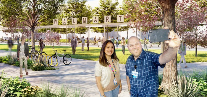 A mockup of the Walmart campus with two people taking in front of an old Walmart sign.