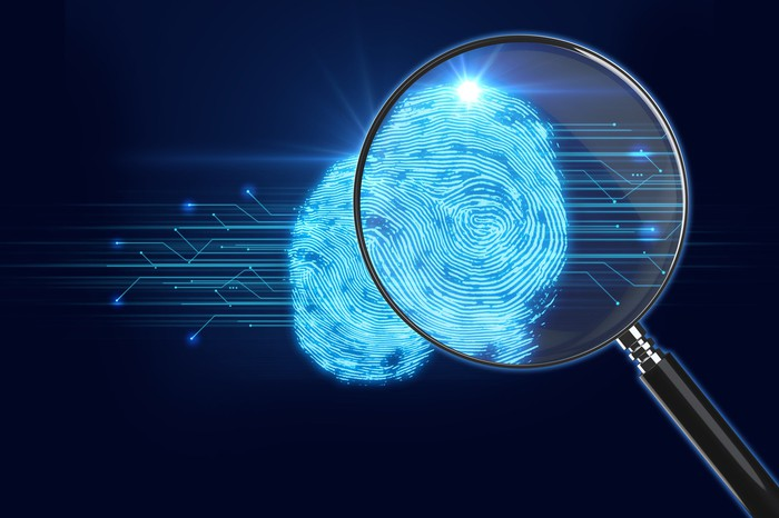 Magnifying Glass on digital fingerprint background
