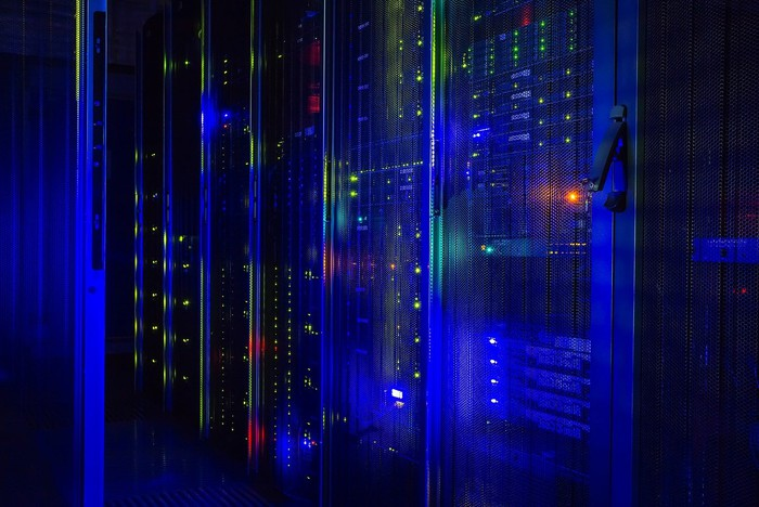 Data center mainframe with blue lighting.