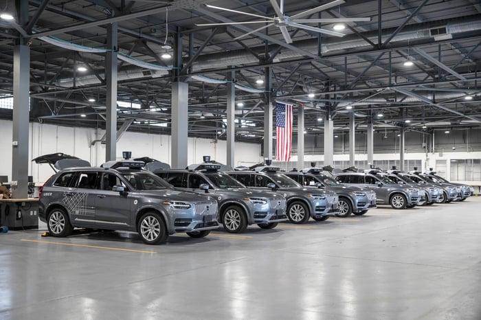 Uber's autonomous vehicles in a warehouse.