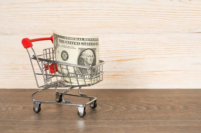 A dollar bill in a shopping cart.