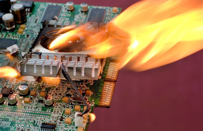Close-up of a circuit board on fire