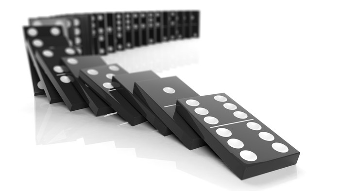 A collection of dominoes falling in line.