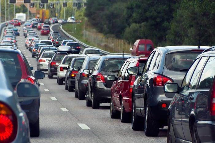 A long line of car traffic on a freeway