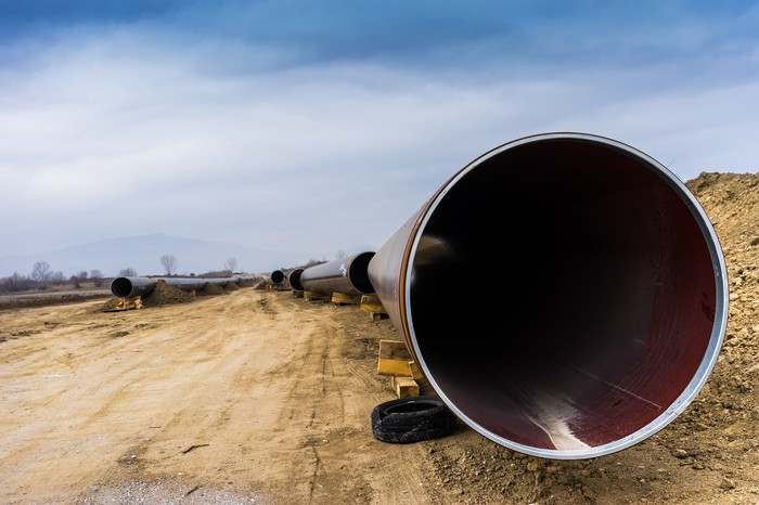 A close-up of a pipeline under construction.