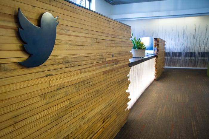 A reception desk with a Twitter bird decal.
