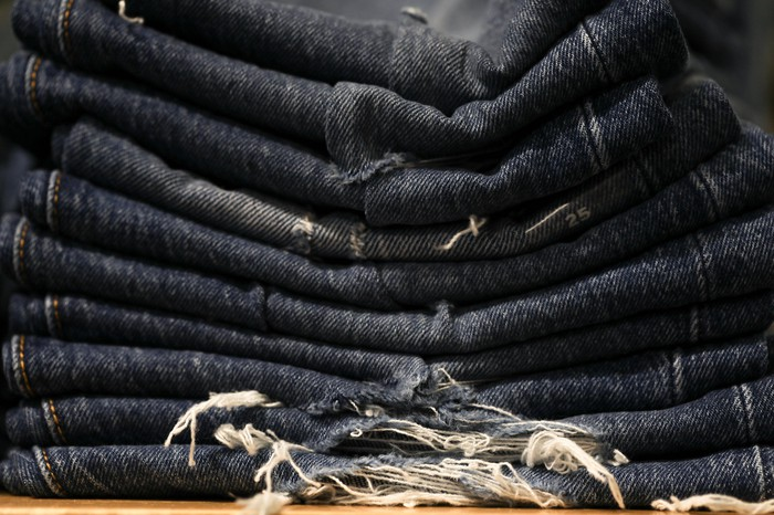 A stack of ripped blue jeans.