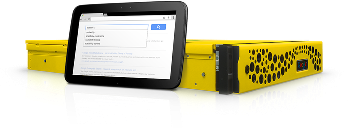 A photo of Google's original yellow and black search appliance with a small tablet stood up against the side