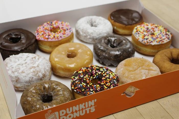 A box of a dozen assorted Dunkin' Donuts doughnuts.