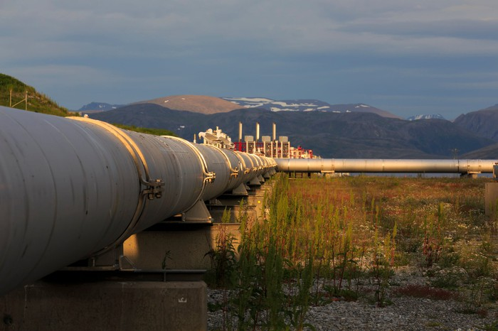 A pipeline with some mountains in the background.