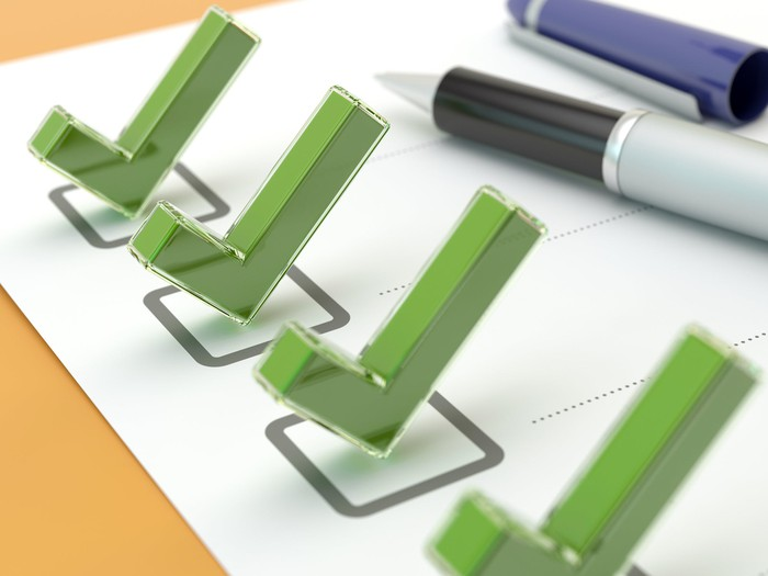 A 3D illustration of check marks on a page with dotted lines next to them.