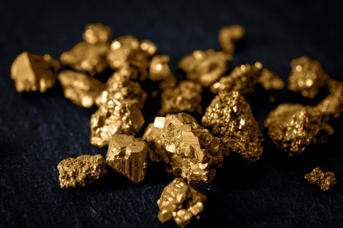 Gold nuggets with a black background.
