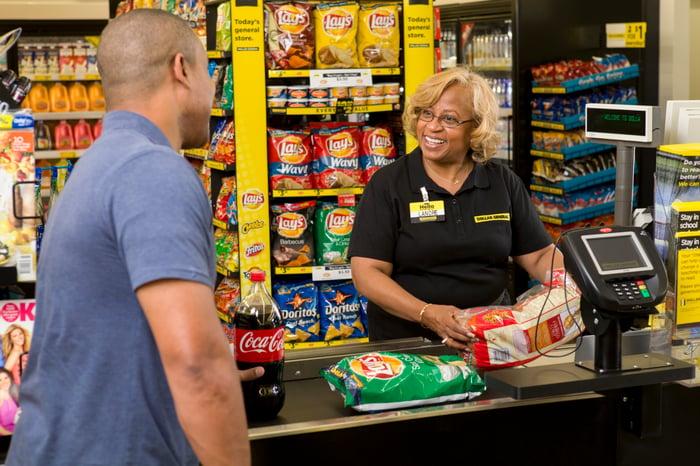 Cashier ringing up customer at checkout