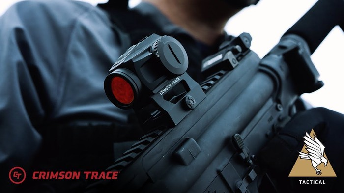 A laser sight mounted on a rifle.