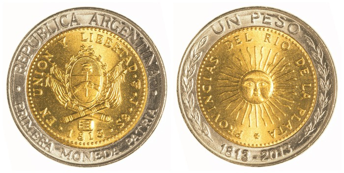 Head and tail sides of an Argentinean peso.