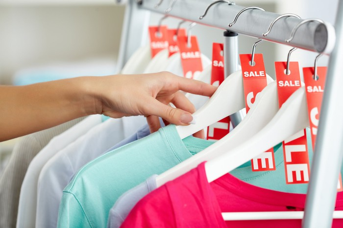 Woman looking at clothes marked for sale