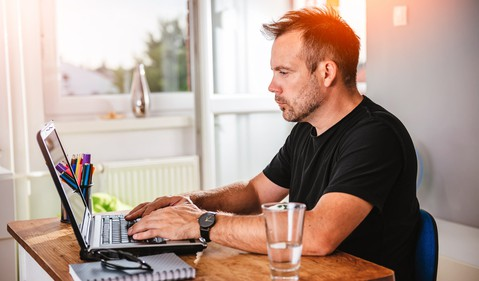 man typing on laptop_GettyImages-614422138