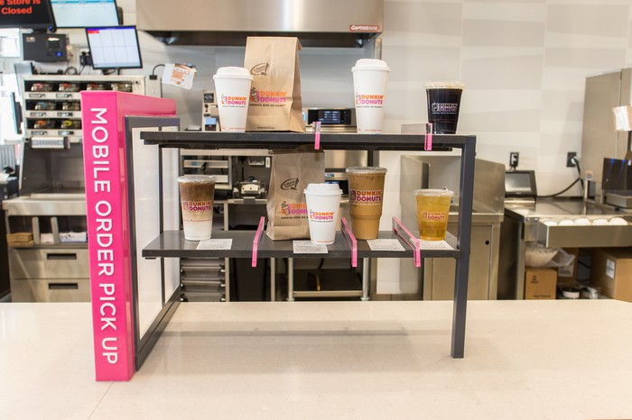 A mobile order pick-up counter at a Dunkin' Donuts store.
