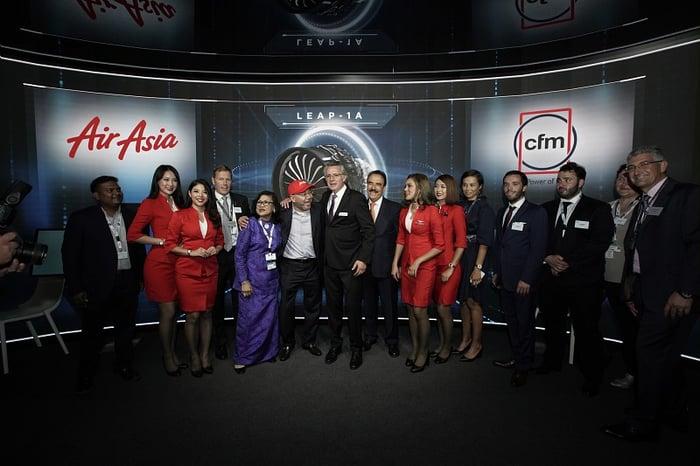Representatives of CFM and AirAsia pose for a photo.