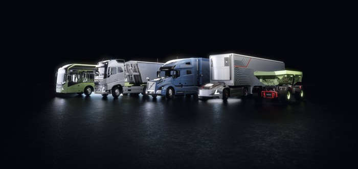 Rendering of six different Volvo autonomous vehicles, including several trucks and a bus.