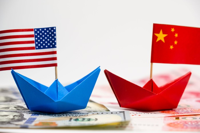 Two paper boats adorned with the American and Chinese flags.