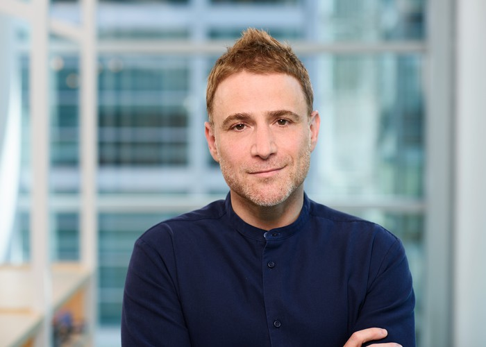 Stewart Butterfield with an out-of-focus window behind him