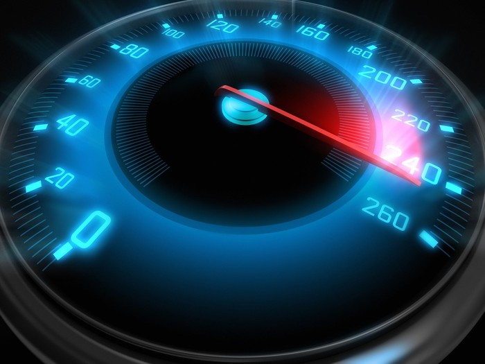 A speedometer with glowing blue numbers shows a red needle pushing past the number 240.