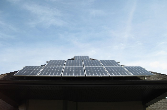 An array of solar panels on the roof of a home