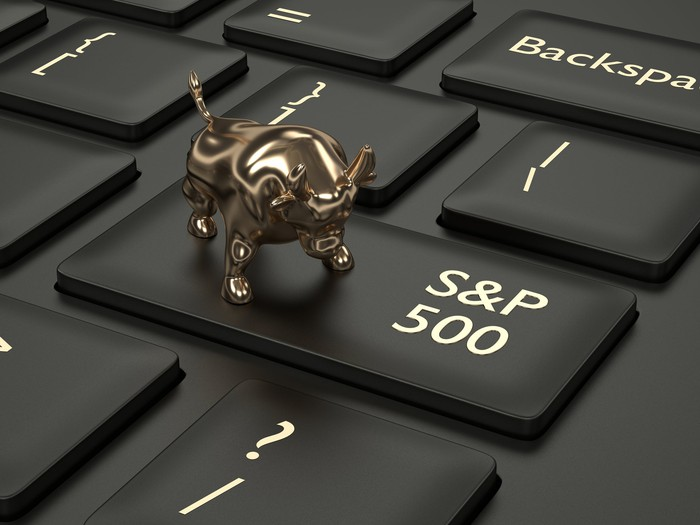 A miniature bull on top of the return key on a keyboard that says S and P 500.