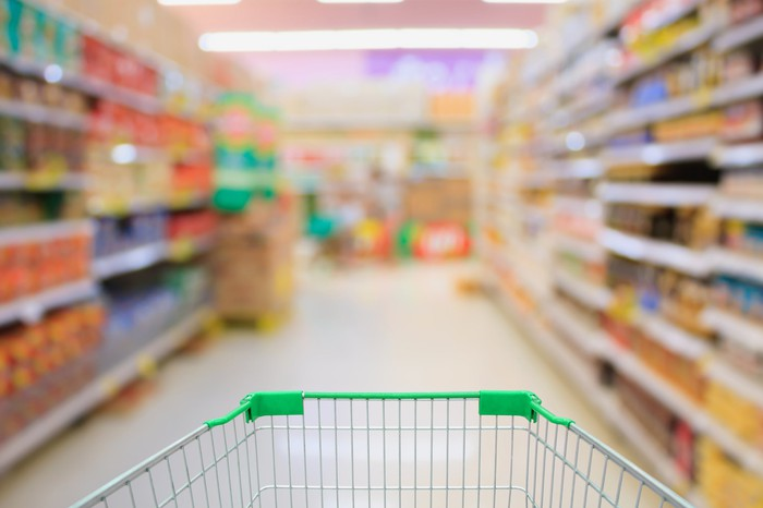 A grocery store aisle from the perspective of someone pushing a shopping cart.