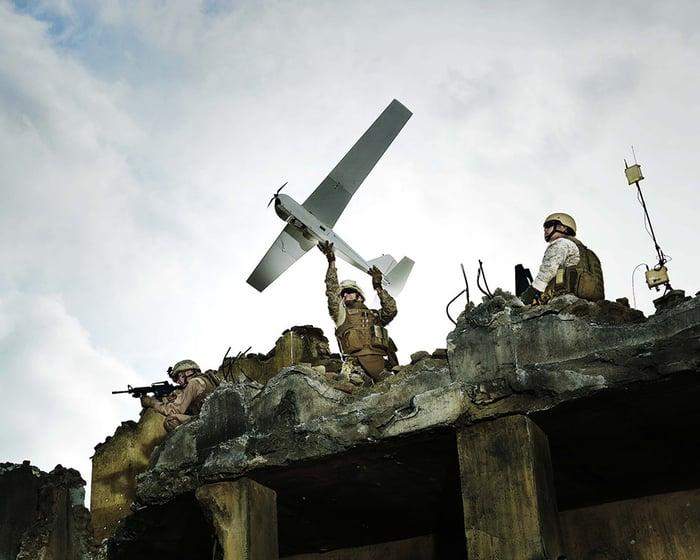 A soldier prepares to launch an AeroVironment Puma AE drone.