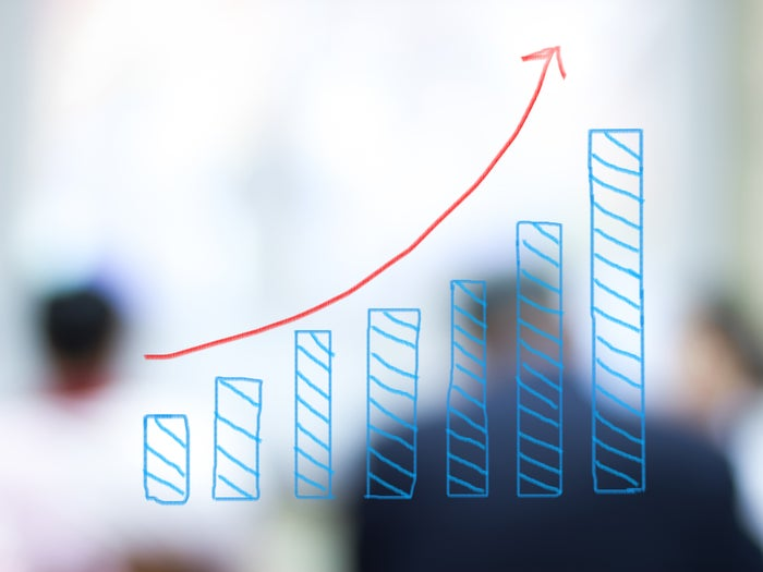 A sketch of a bar chart in blue with a red arrow highlighting a growth trend.