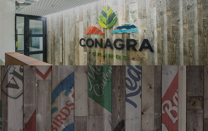 Wood paneled wall with Conagra logo, and slips of brands.