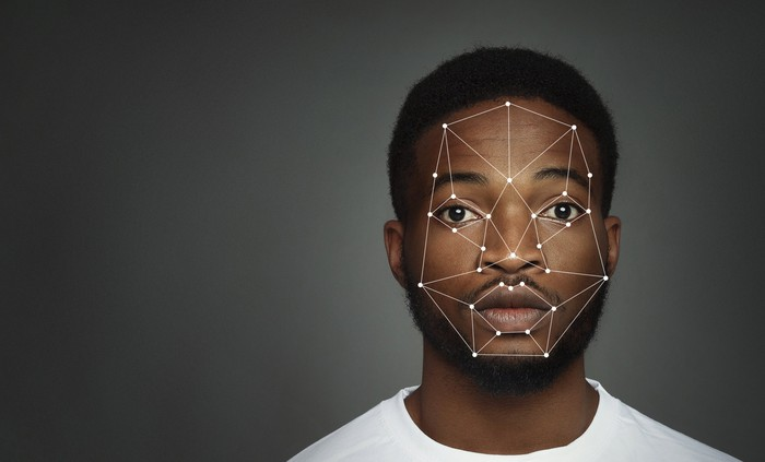 Representation of facial recognition technology on black male's face