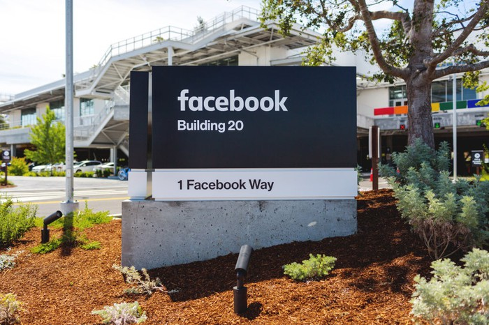 Facebook sign and building in California.