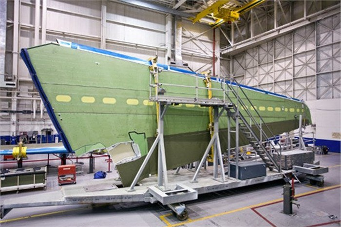 A business jet wing assembly in production.
