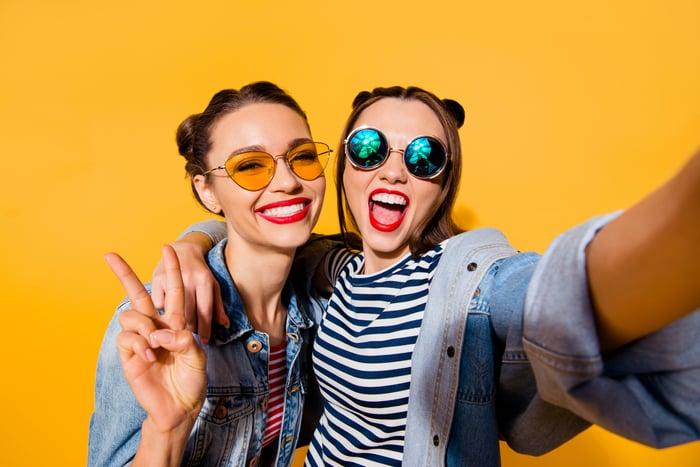 Two young women take a selfie.