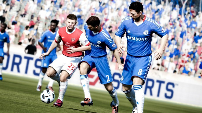Five players in a FIFA video game with EA Sports banner in background.