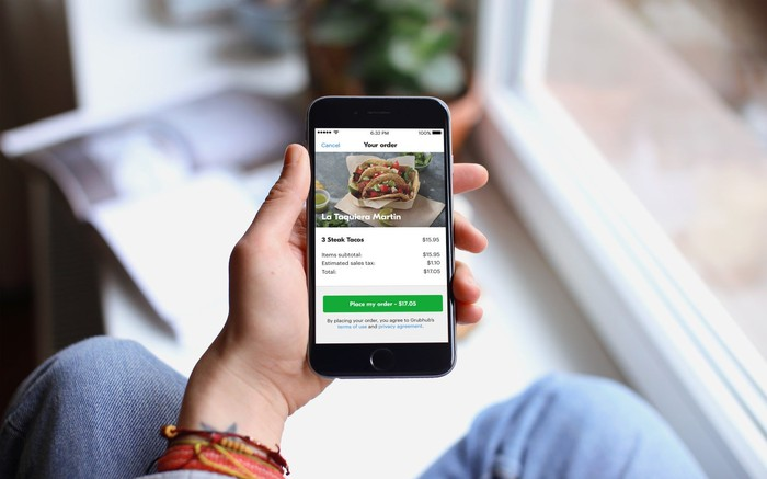 Person placing an order using Grubhub mobile app