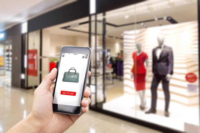 A shopper checks a bag on a smartphone app.