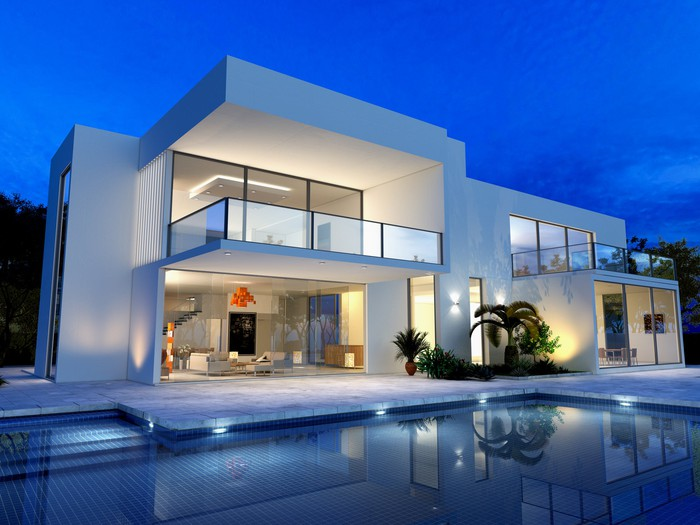 a large modern home with a pool