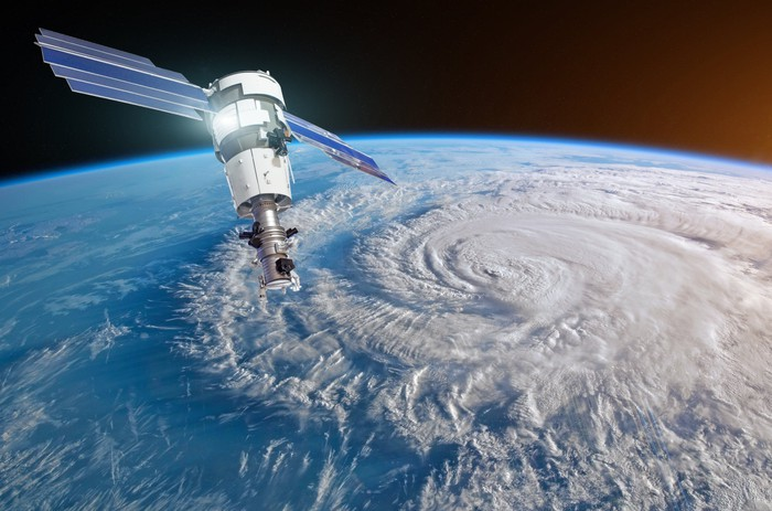 Satellite in orbit over a hurricane on Earth