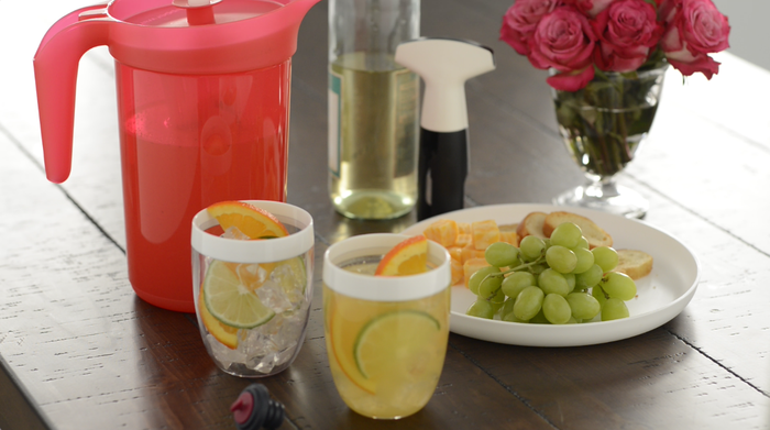 Pineapple sangria and a side of fruit being served on Tupperware goods.
