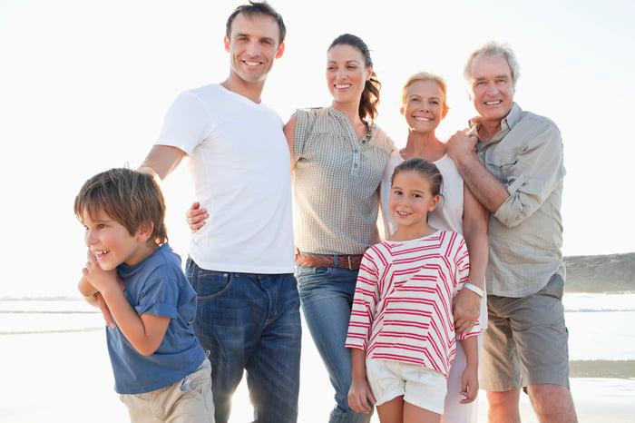 A multi-generational family portrait on a beach.