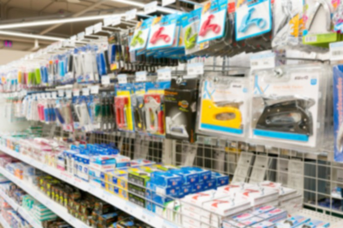 A store aisle with various supplies for arts, crafts, and the office.