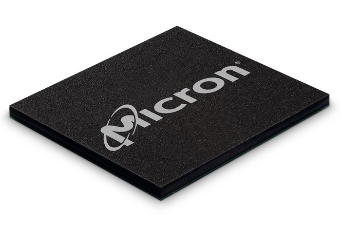 Close-up shot of a NAND memory chip, sporting Micron's corporate logo in grey on black.